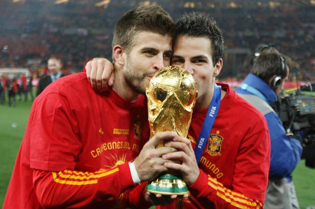Pique and Fabregas with World Cup trophy