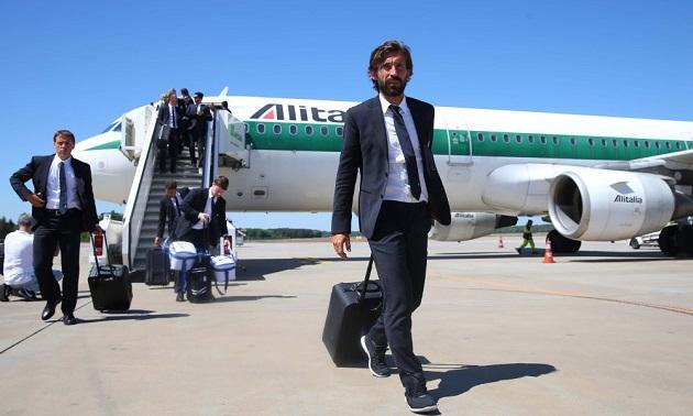 Andrea Pirlo steps off plane