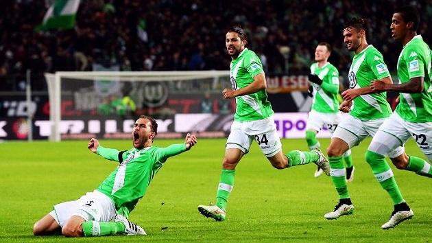 Wolfsburg's Bas Dost scores