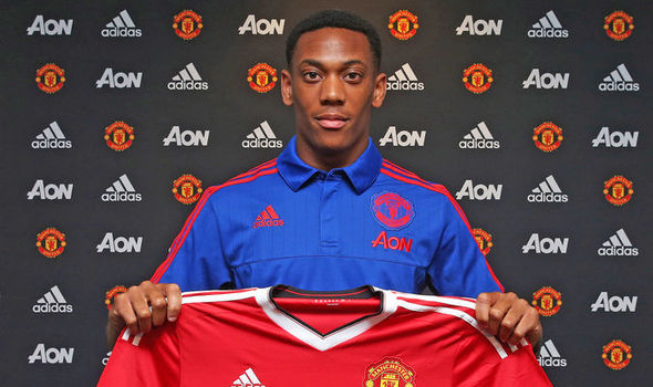 Anthony Martial signs with Man United